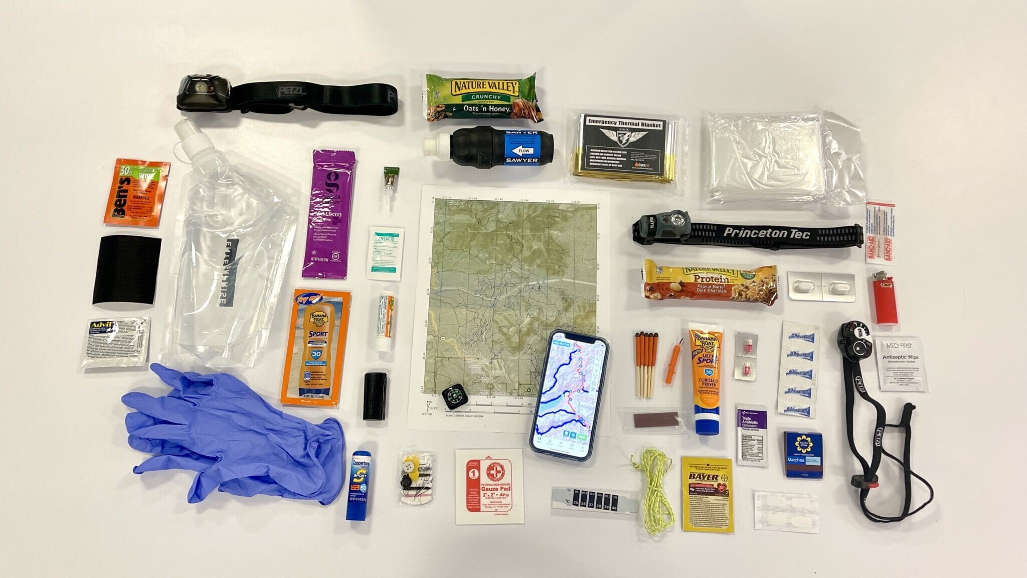hiking essentials lying across a table