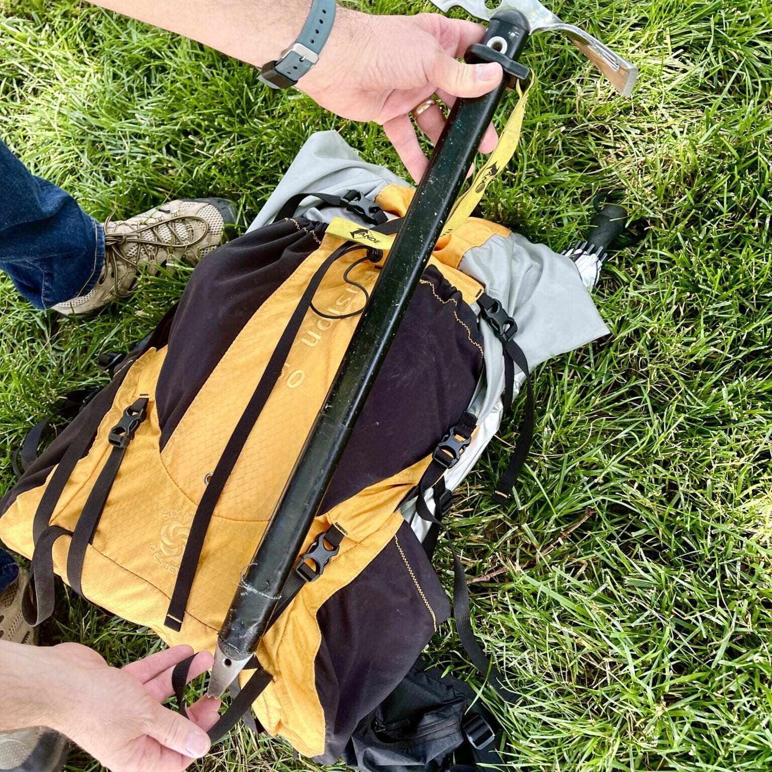 ice axe going through the loop of a backpack