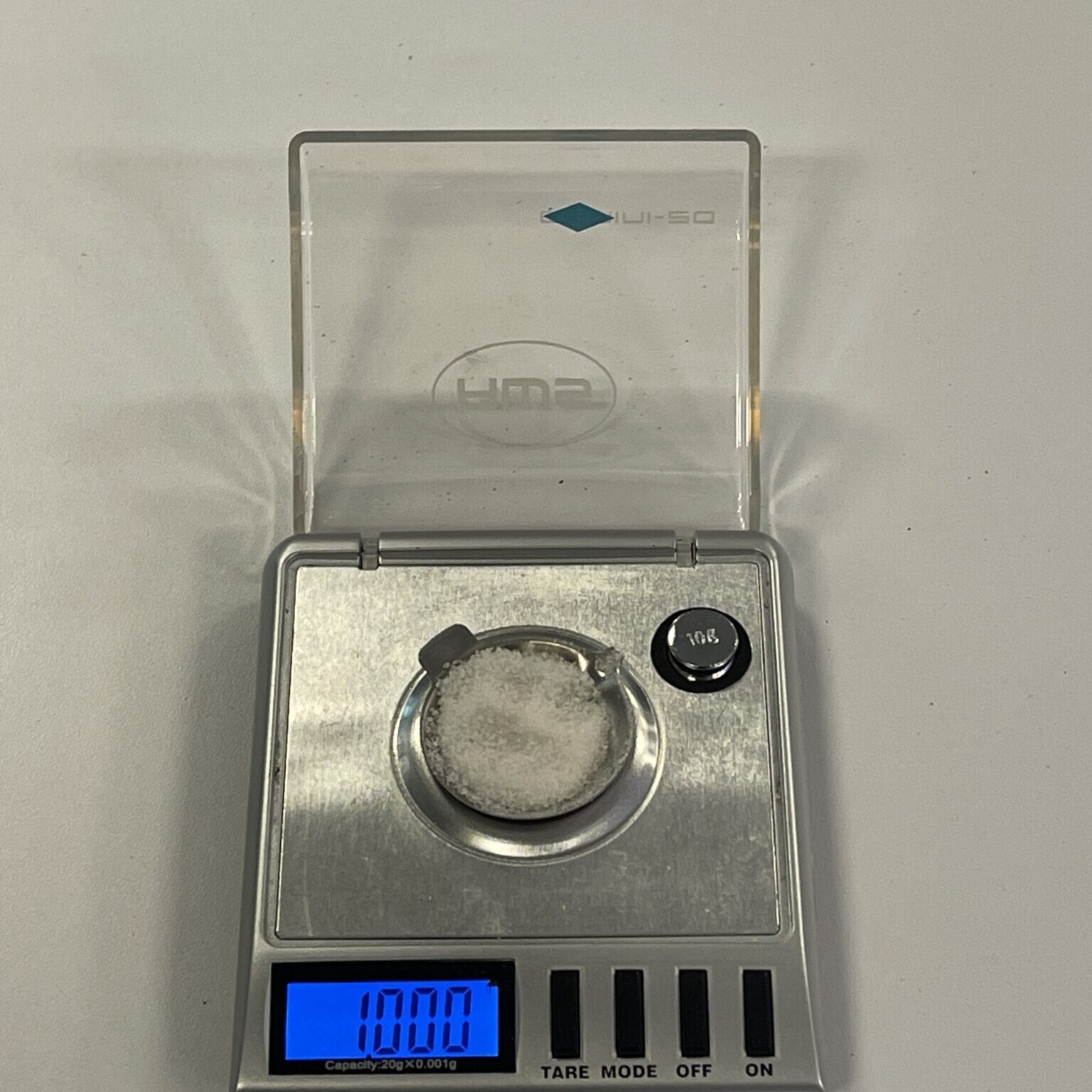 the gel being weighed onto a scale