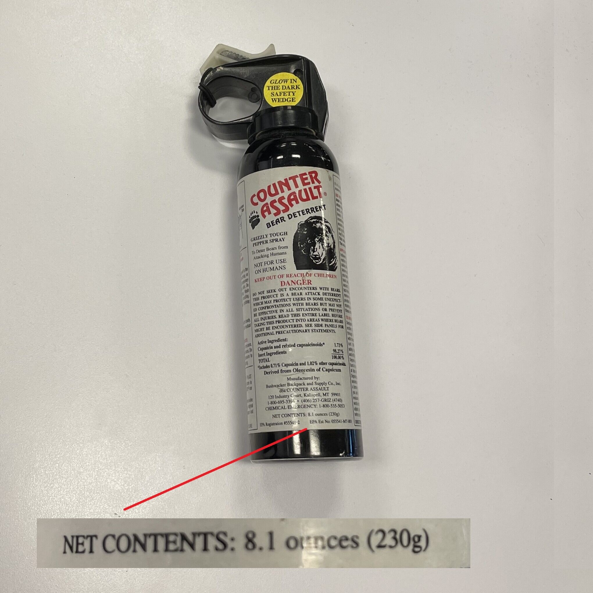 A can of bear spray with with an arrow pointing to how many ounces are in the can