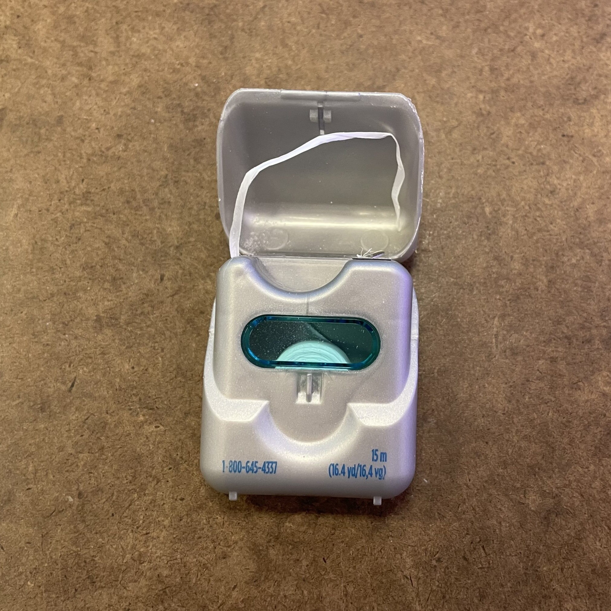 a floss container