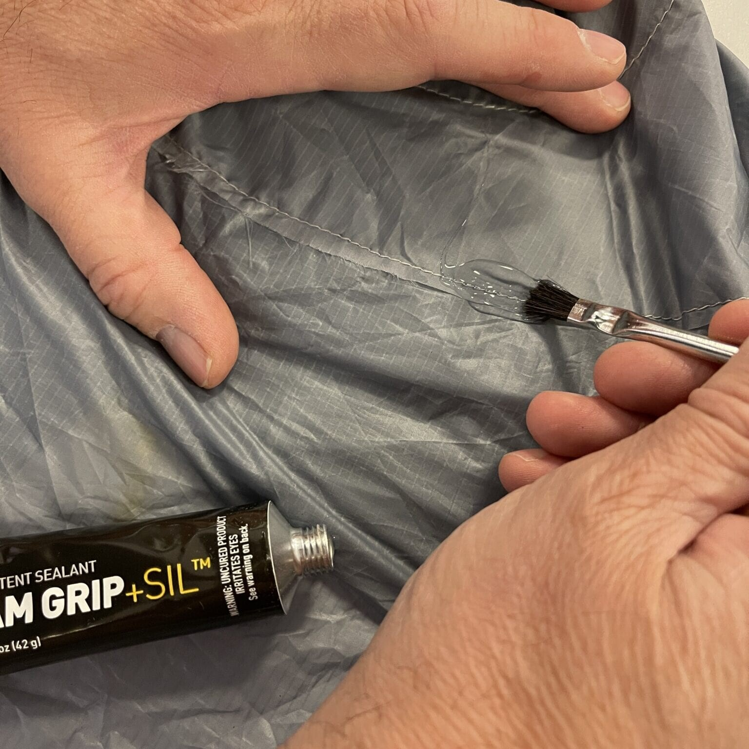 tent sealant being applied to a tent