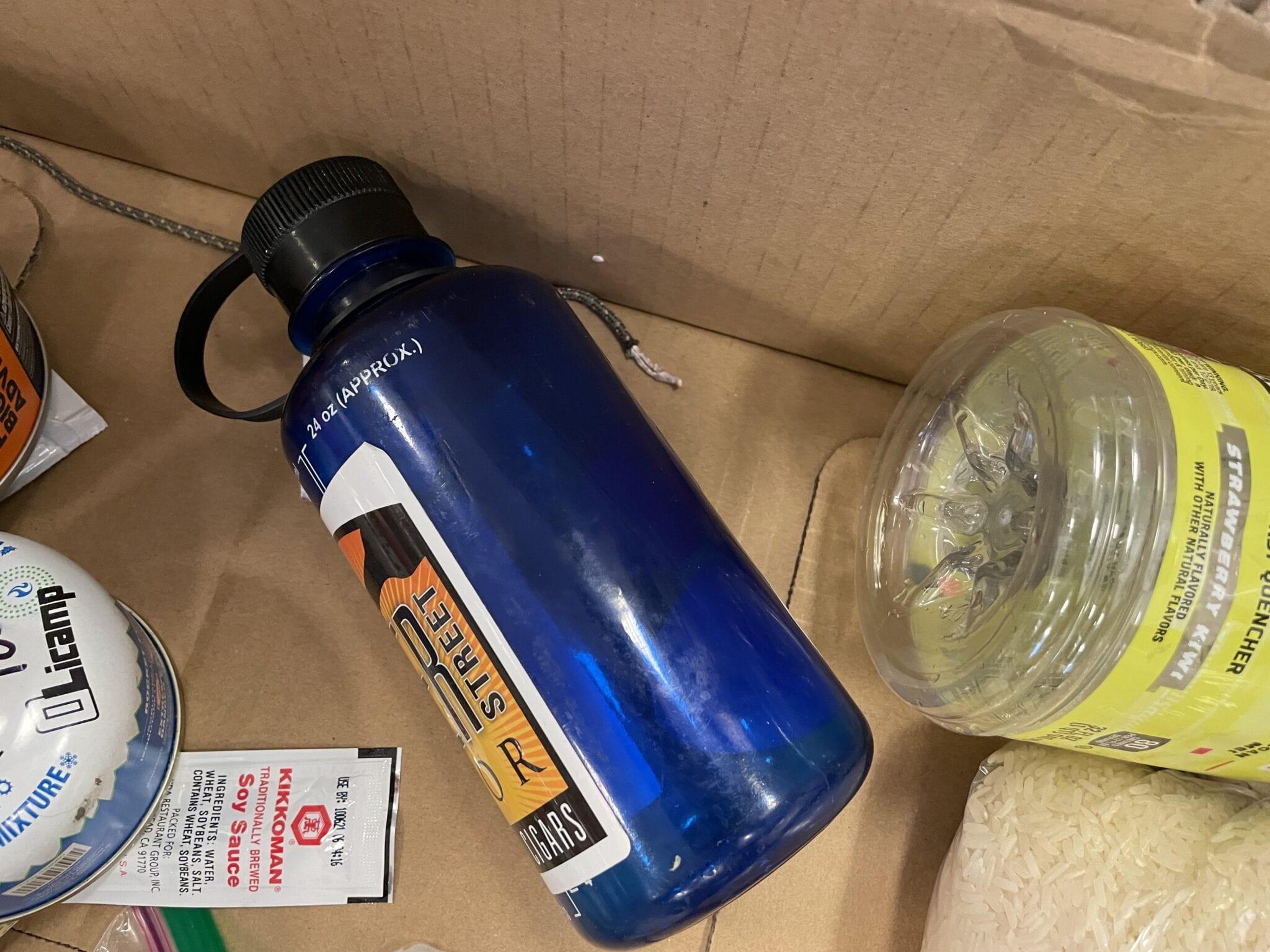 plastic water bottles in hiker box