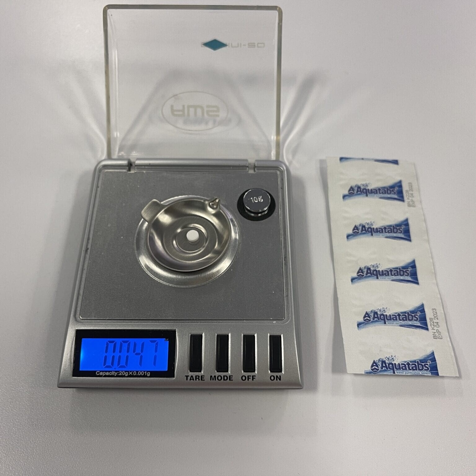 aqua tabs being weighed on a scale