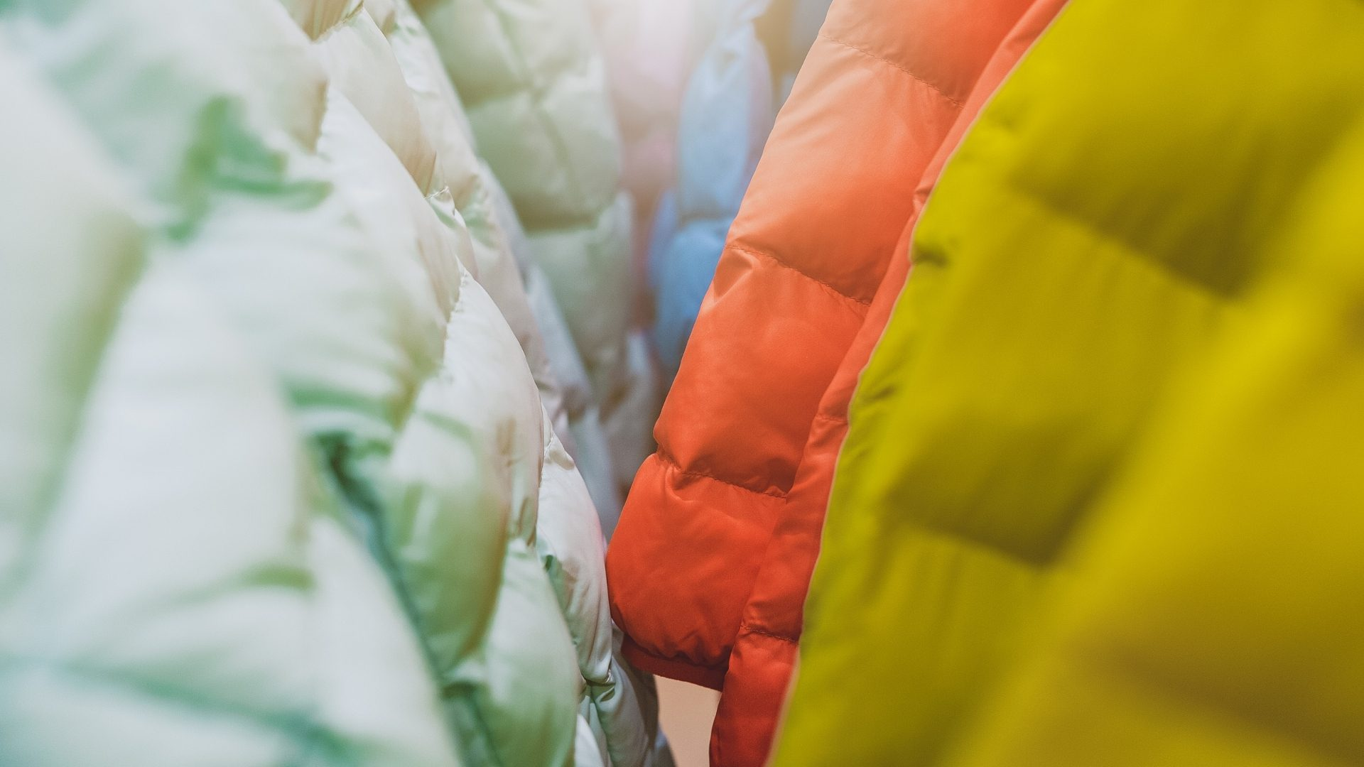 Colorful down and synthetic jackets hanging