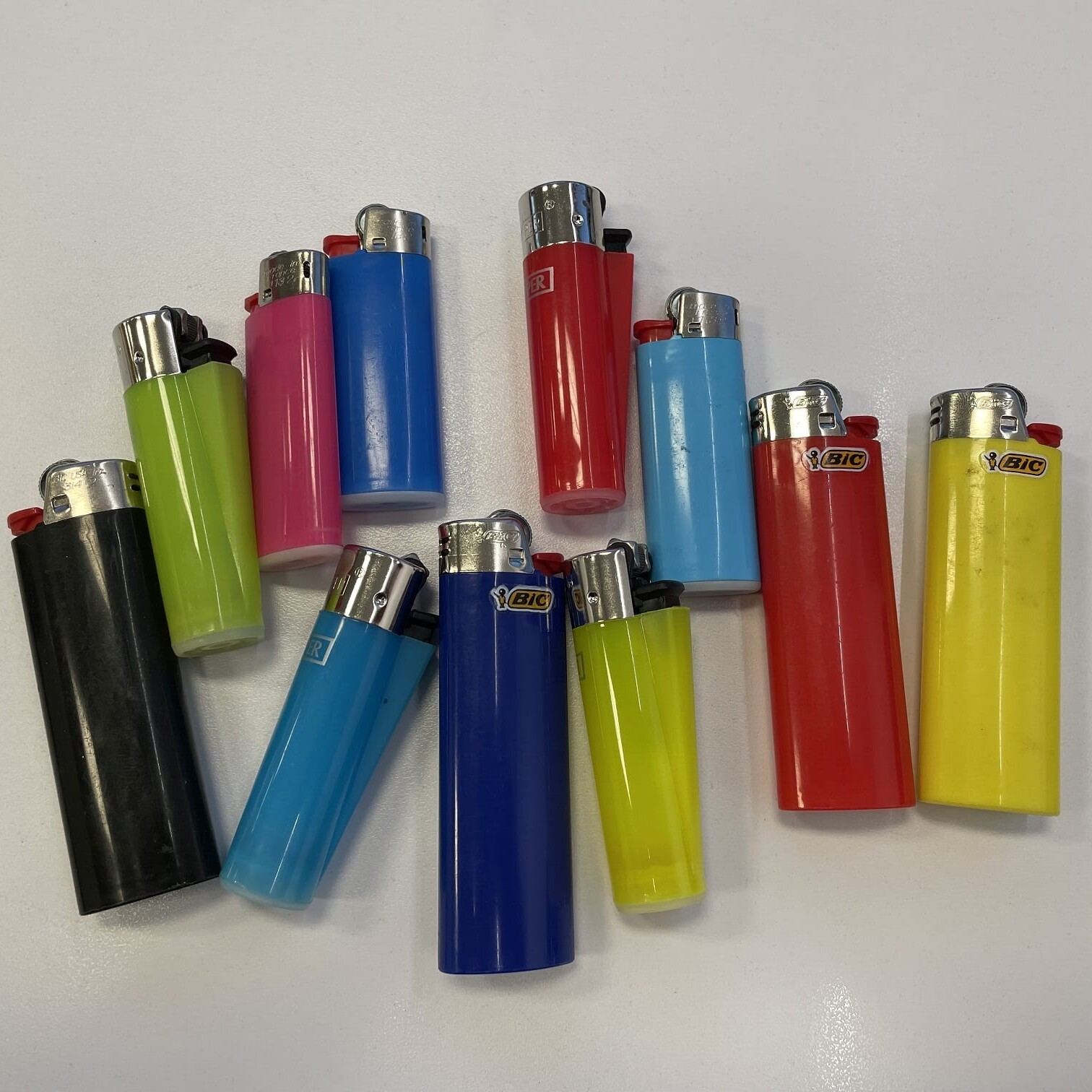 a pile of different lighters on a table