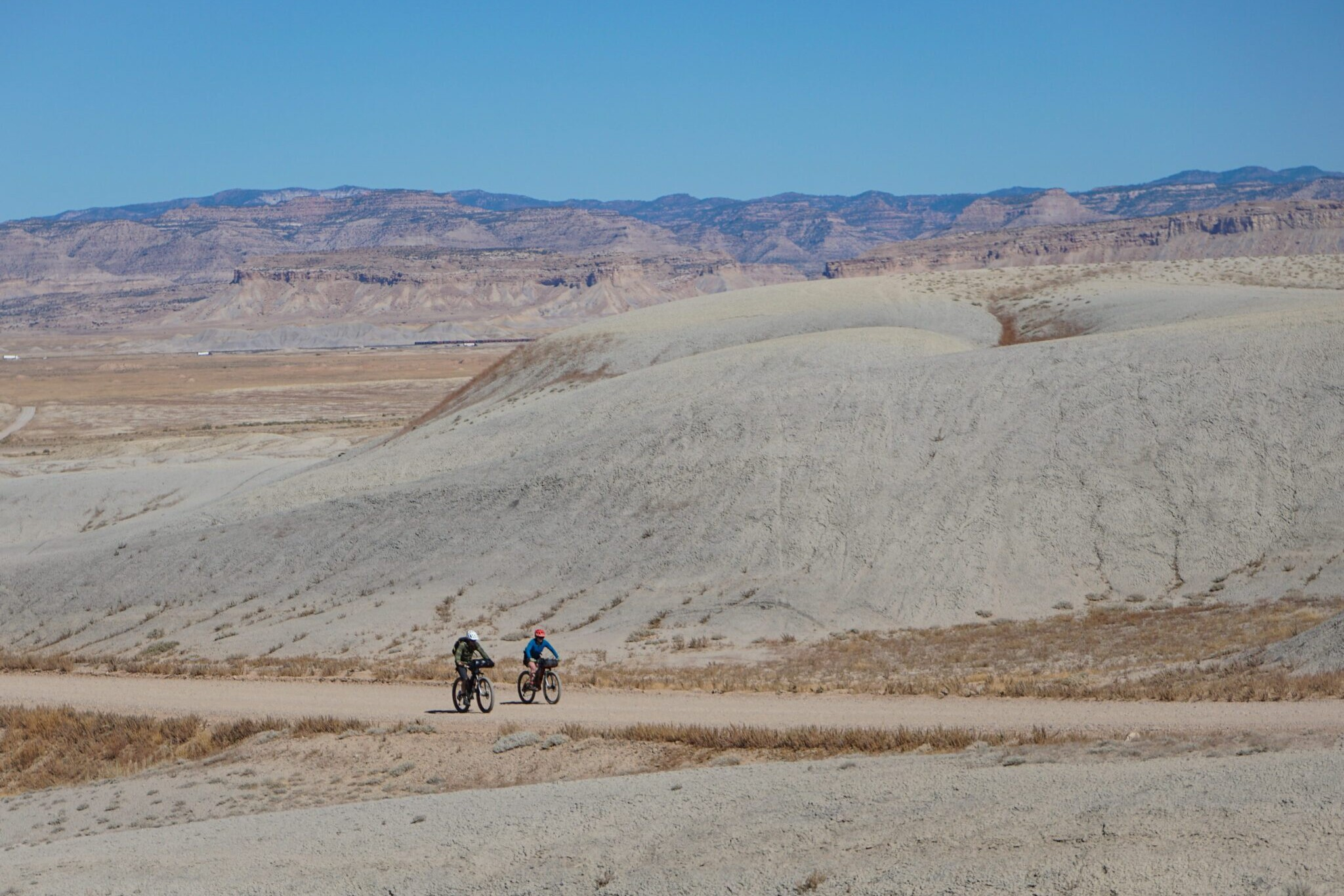 two bikepackers riding on the Bears Ears Loops trail