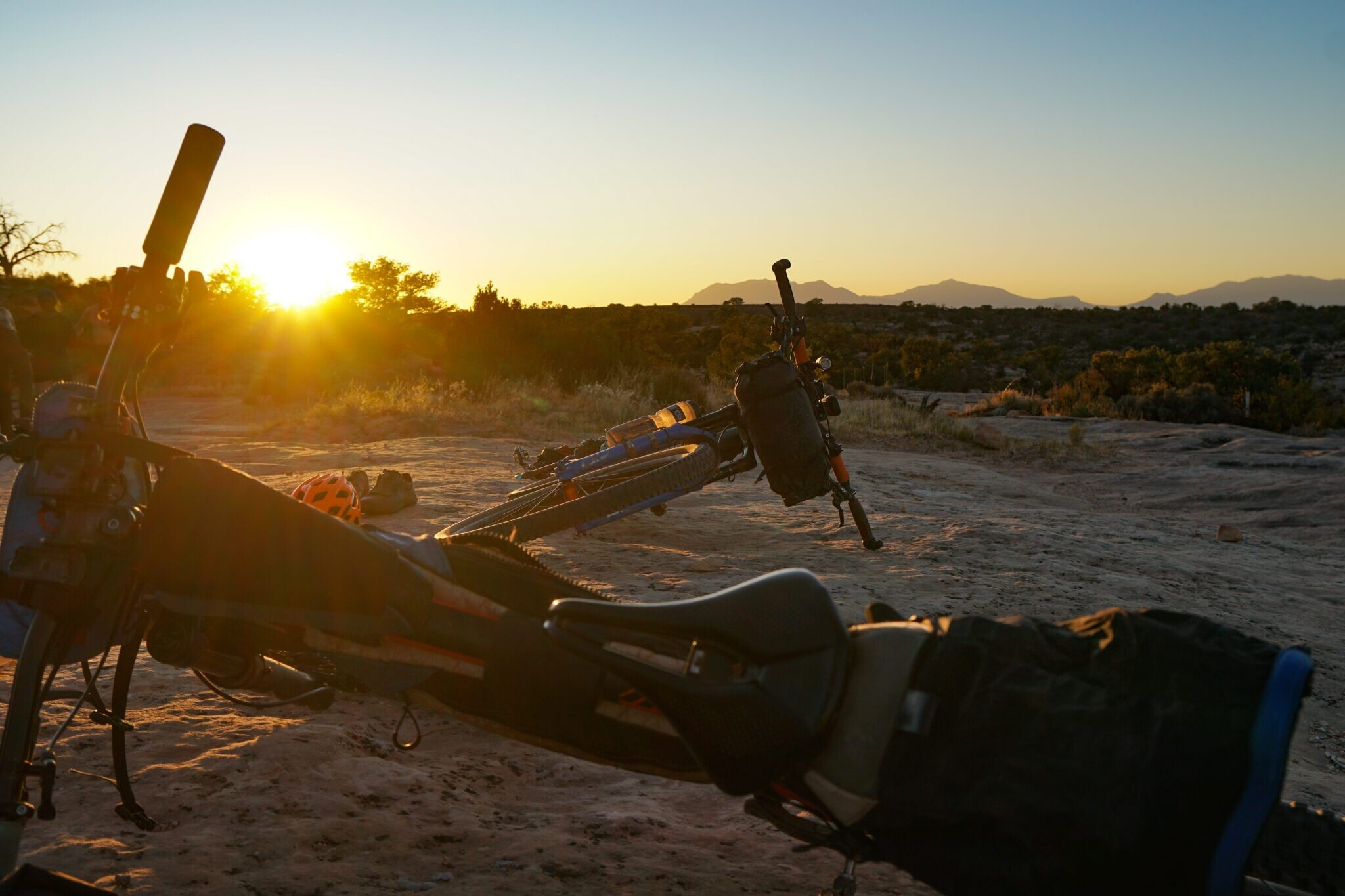 two bikepackers bikes resting during the sunset
