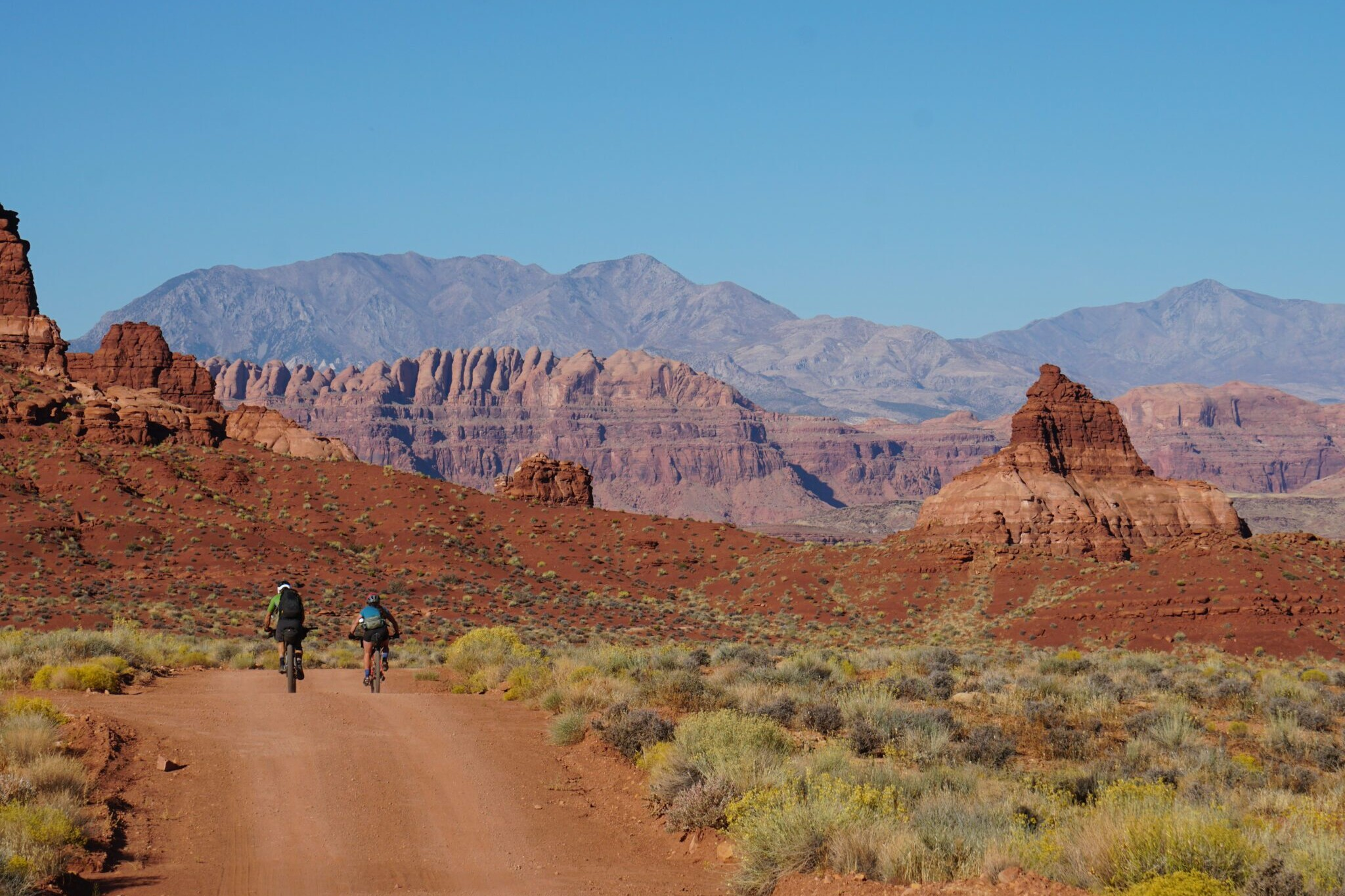two bikepackers going off into the distance on the Bears Ears Loops trail