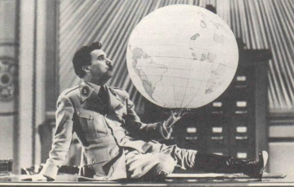 Charles Chaplin as Hitler in The Great Dictator