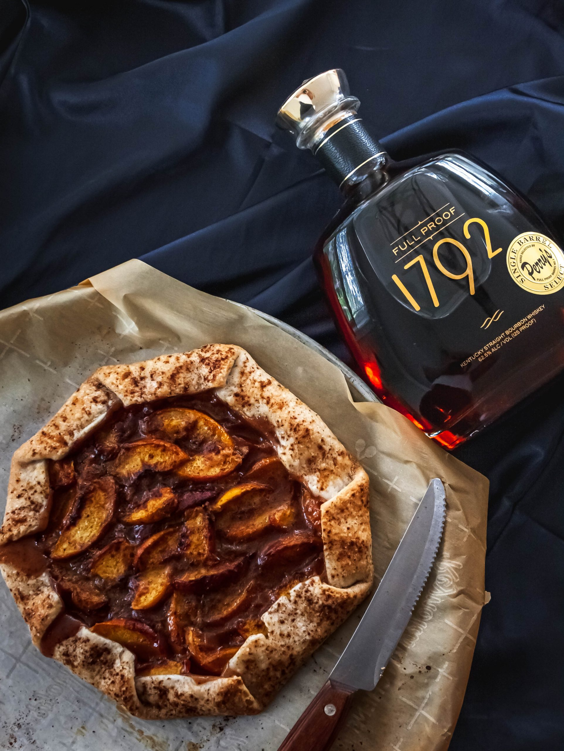 Food photography of peach bourbon galette