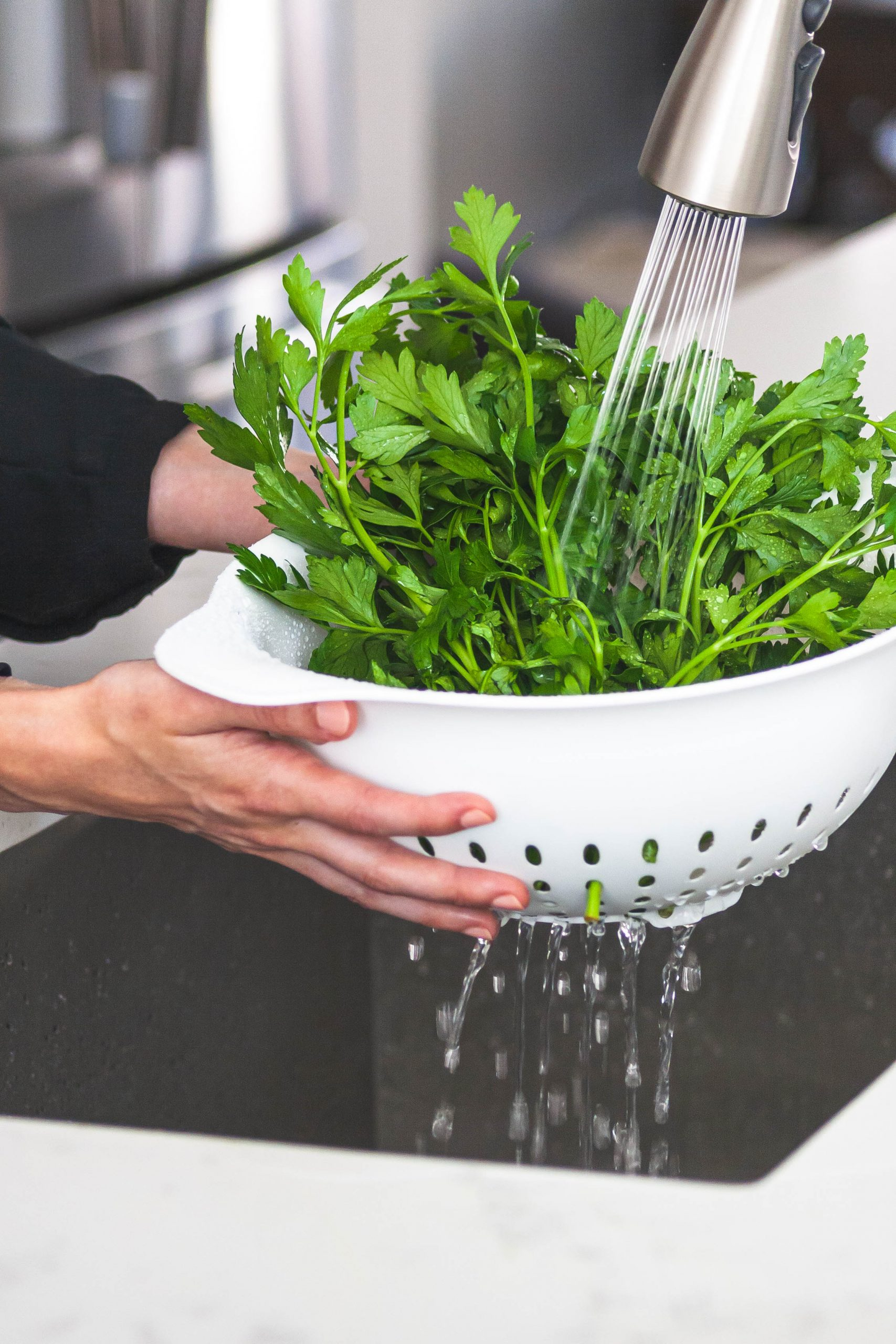 Picture of rinsing herbs in a colander