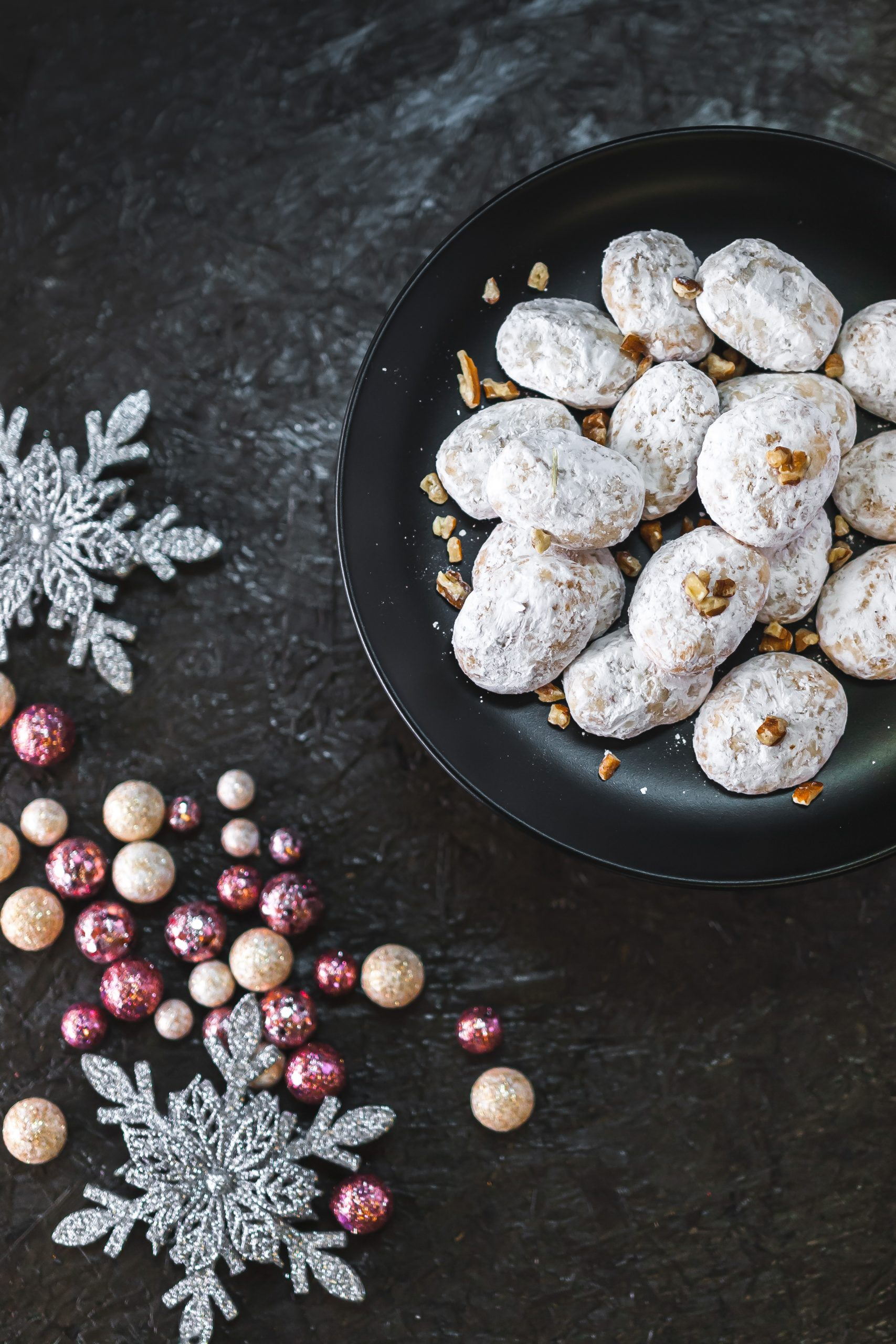 Winter food photo of pecan shortbread with snowflakes