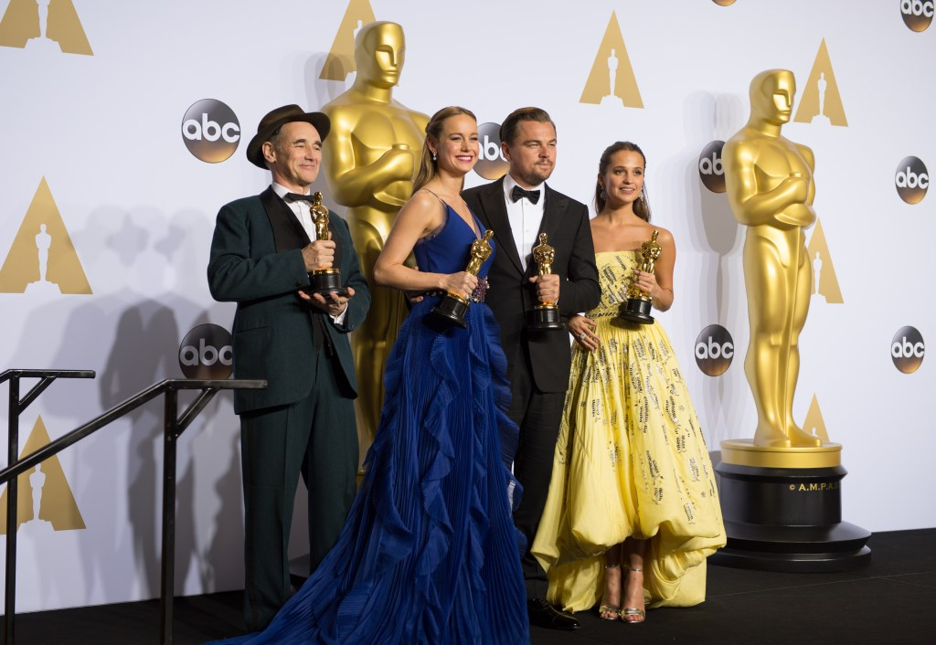 """Oscar®-winner, Mark Rylance, for his Performance by an actor in a supporting role, for his role in """"Bridge of Spies""""; Oscar®-winner, Brie Larson, for her Performance by an actress in a leading role, for work on """"Room""""; Oscar®-winner, Leonardo DiCaprio, for his Performance by an actor in a Leading role, for work on """"The Revenant""""; Oscar®-winner, Alicia Vikander, for her Oscar® for Performance by an actress in a supporting role, for her role in """"The Danish Girl"""" poses backstage after the live ABC Telecast of The 88th Oscars® at the Dolby® Theatre in Hollywood, CA on Sunday, February 28, 2016."""