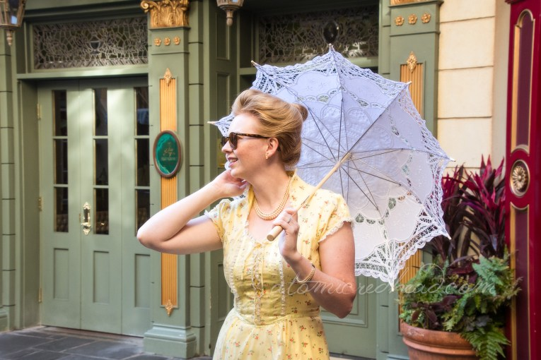 Spring Dapper Day outfit, long yellow dress with small floral print with a white lace parasol.