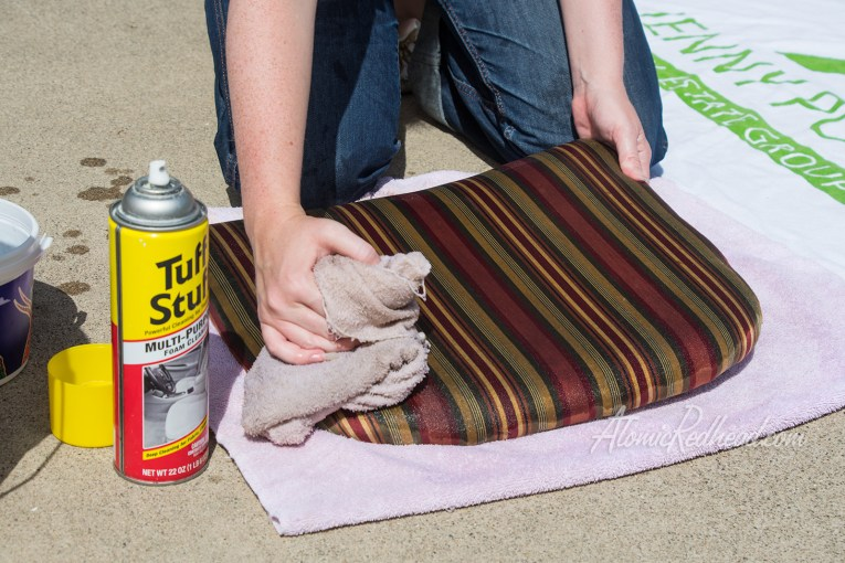 Wipe off excess Tuff Stuff with another damp rag