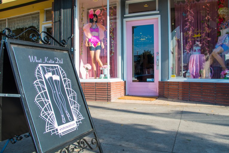 What Katie Did storefront with sandwich board and mannequins wearing vintage style lingerie.