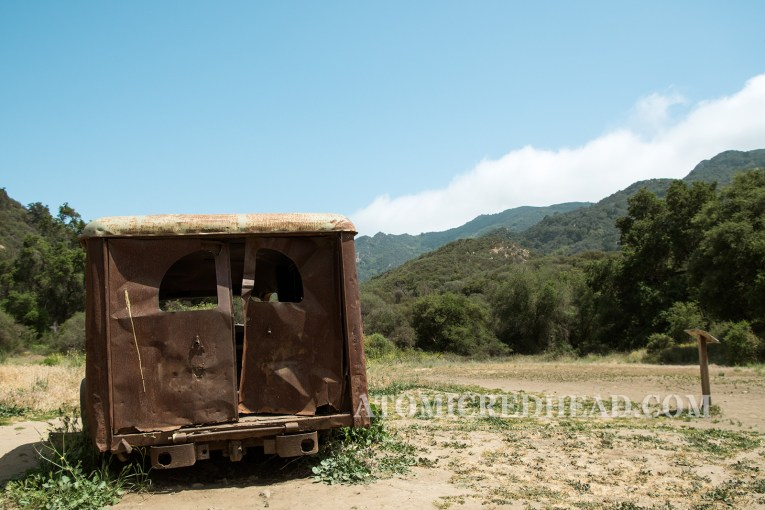The back of the old ambulance with the hills in the background.