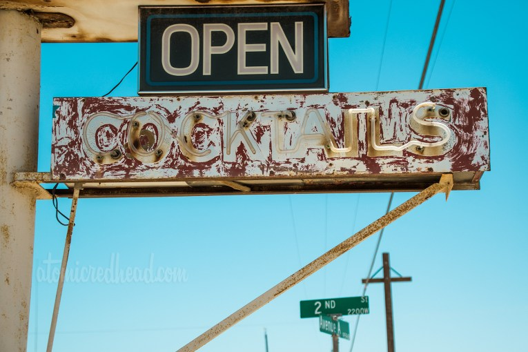 """Faded paint and broken neon, reading """"Cocktails"""""""