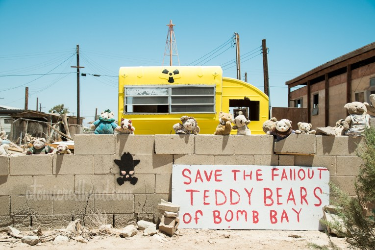Art Instillation: Save the Fallout Teddy Bears of Bomb Bay - teddy bears and a trailer painted yellow with nuclear waste symbol
