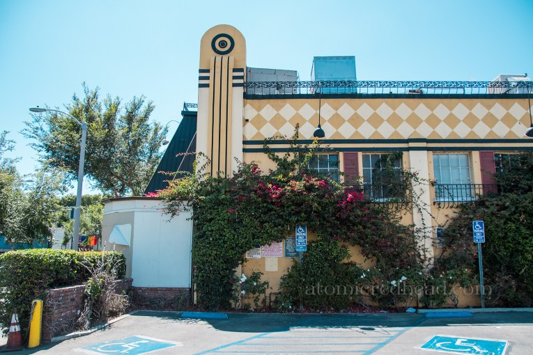 Side of the building, showcasing a 30s streamline art deco portion jutting from the side, which is rounded at the top.