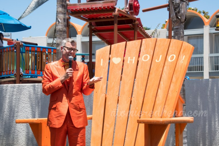 Charles Phoenix, in his orange suit, speaks about the history of HoJo.