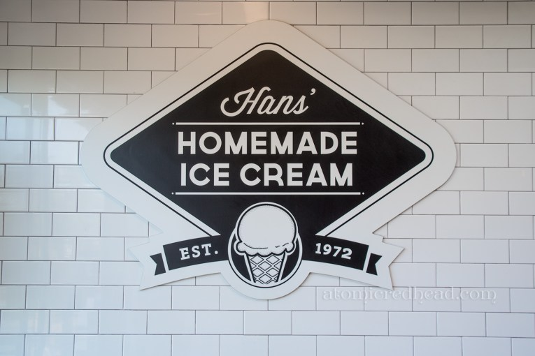 Hans' Homemade Ice Cream sign, black and white, established in 1972.