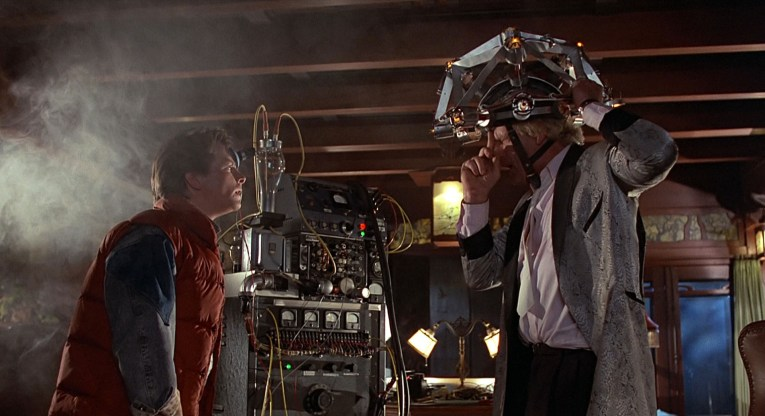 Screencap from Back to the Future, inside the Blacker House, which was used as the interior of Doc Brown's House. Doc Brown tries to read Marty's mind. Dark wood ceilings, stained glass in the background.