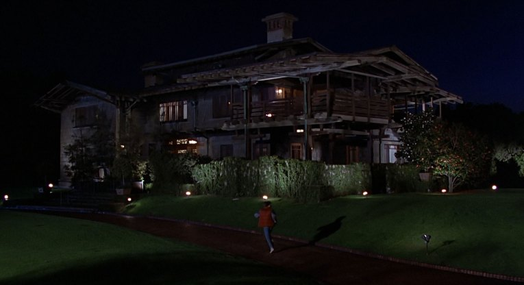 Screencap from Back to the Future - Marty arrives at Doc Brown's House, which is the Gamble House.