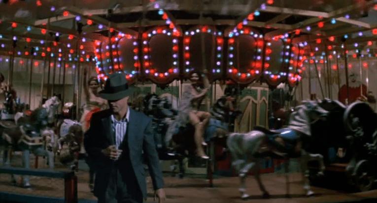 Hooker walks away from the carousel.