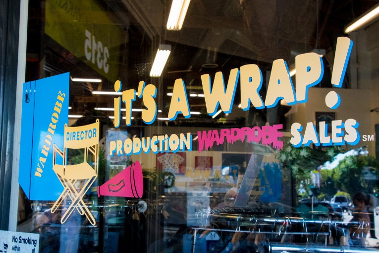 "Window of It's a Wrap, advertising it as ""production wardrobe sales"""