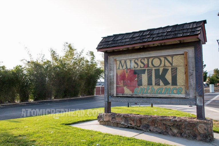 Mission Tiki Drive-In sign, a Hawaiian style sign with pink flower.