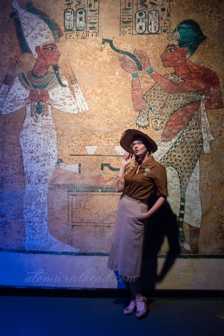 Me, standing against a backdrop that looks like the walls of an Egyptian tomb.