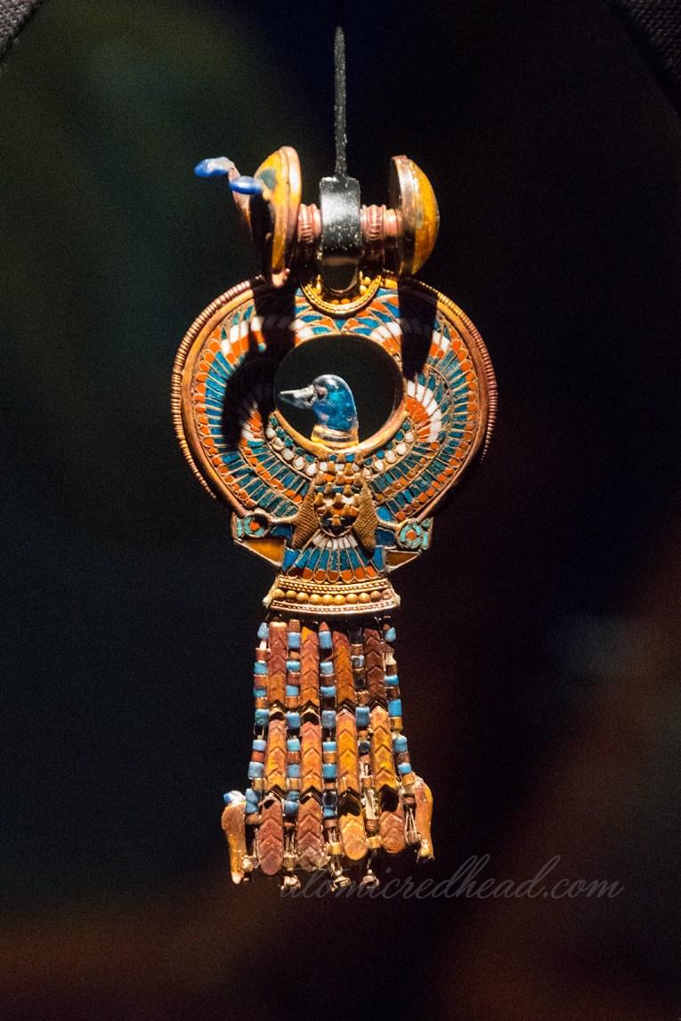 An elaborate earring featuring a bird.