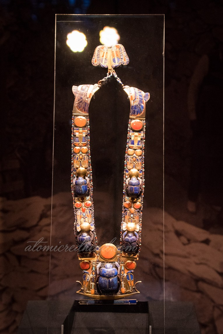 A scarab necklace, made of gold and precious stones.