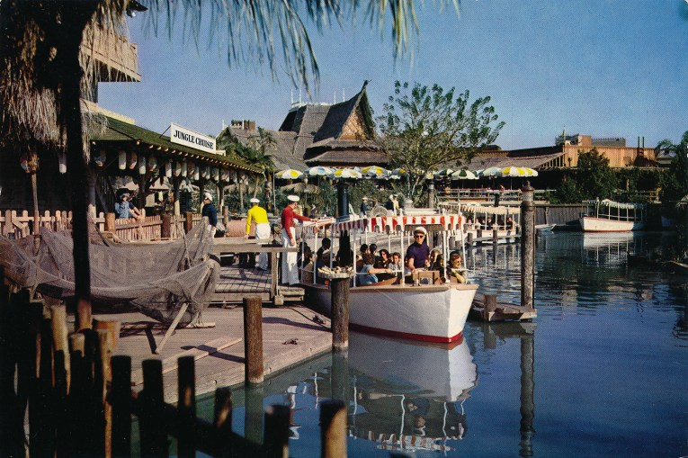 Guests board white boats with awnings of red and white stripes.