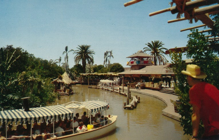 Jungle Cruise boats arrive at the dock.