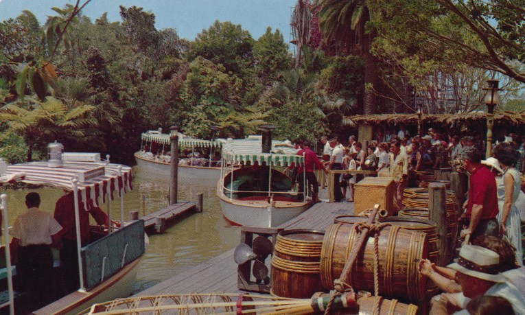 Guests board white boats with awnings of green and white stripes.