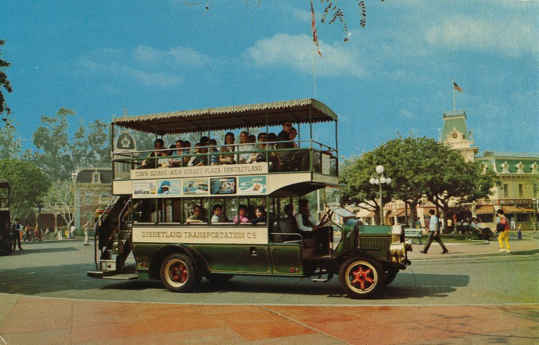 Disneyland's Omnibus, green with red wheels, takes Guests up and down Main Street.