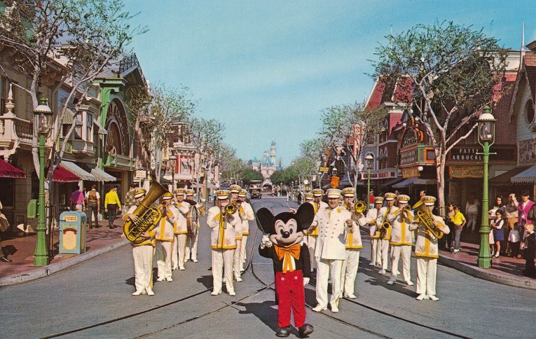 Mickey Mouse leads the Disneyland Band down Main Street.