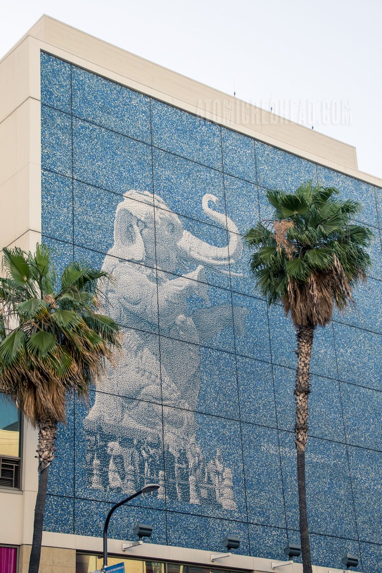 A mural featuring one of the elephant statues in profile.