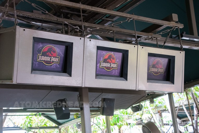 Screens in the queue offer guests insight into Jurassic Park and how the park was created.