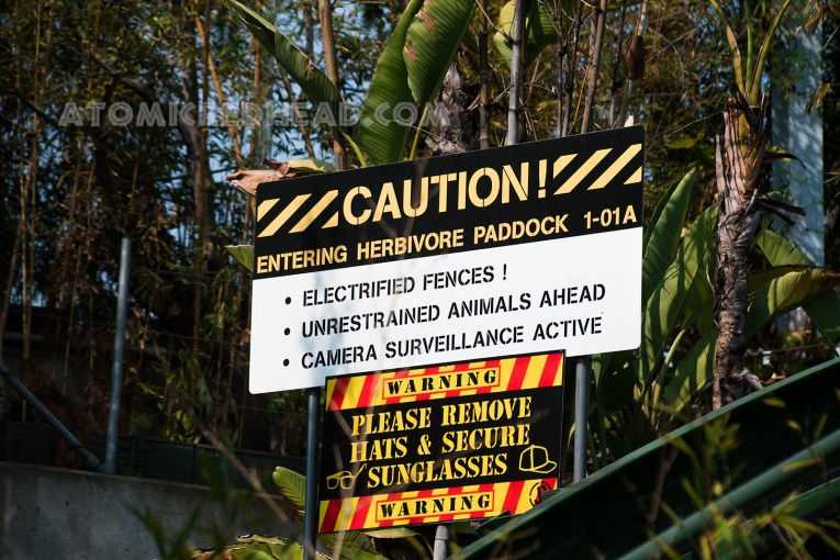 A caution sign lets guests know they are entering the herbivore area and that there is an electrified fence, and unrestrained animals ahead.