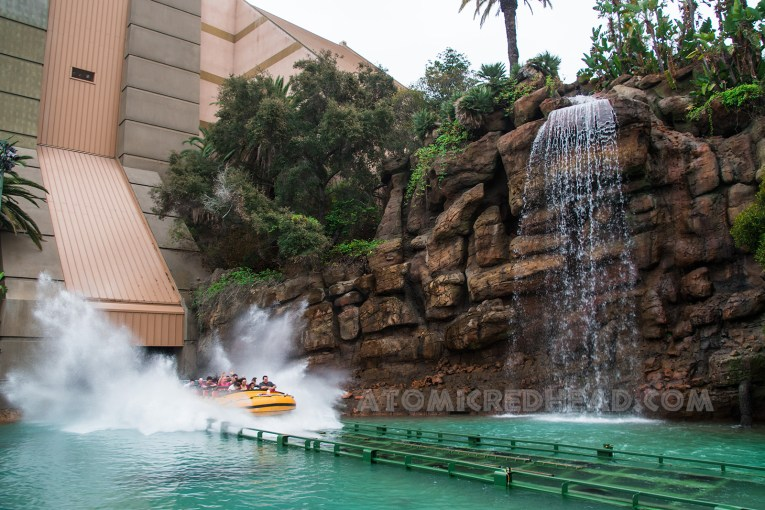 guests make the plunge into the waterfall lagoon below.