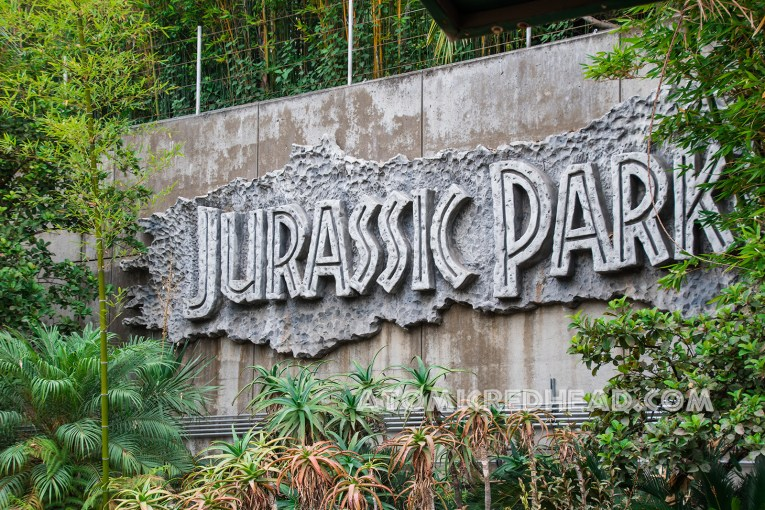 "In large rock work text reads ""Jurassic Park"""