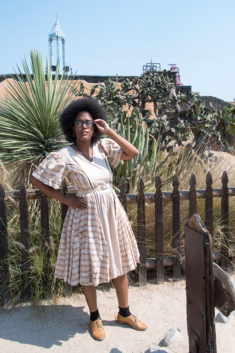 Carla, wearing a vintage H Bar C square dancing dress of cream, tan, and brown plaid.