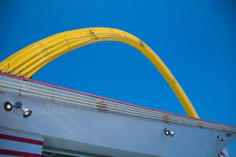 "Yellow ""Golden Arch"" stretches over the slanted roof of the restaurant."
