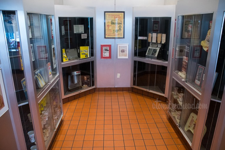 Inside the museum, featuring display cases of vintage McDonald's items.