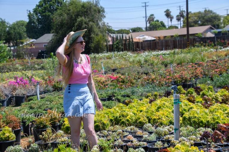Me standing among an array of plants