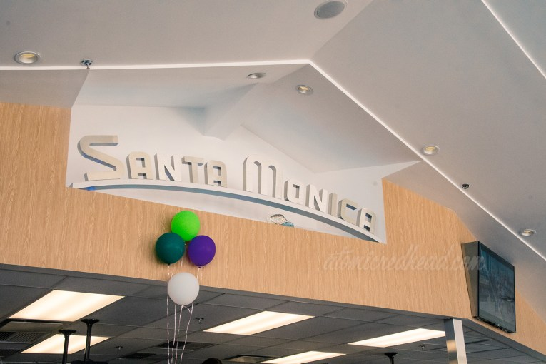 """Above the counter in silver letters reads """"Santa Monica"""""""